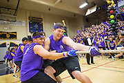 Milpitas High School seniors take down the junior class during the tug-of-war contest during the annual Trojan Olympics, where students compete in various unorthodox events for class bragging rights, at Milpitas High School in Milpitas, California, on March 27, 2015. (Stan Olszewski/SOSKIphoto)