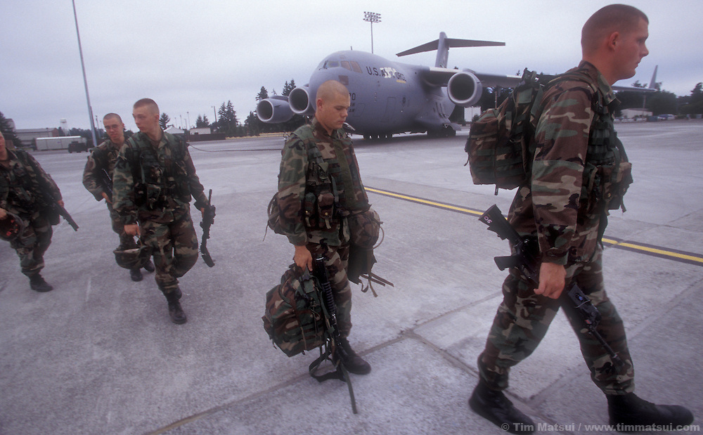 Stryker Brigade soldiers from Ft. Lewis prepare to board a C-17 to fly to the National Training Center in Ft. Irwin, Calif. on Thursday, July 25, 2002. The army has only had the Stryker for a month and this is their debut in maneuvers at 'war' at Ft. Irwin for the Millennium Challenge 2002 Experiment (MCO2)...The Stryker has a communictions package, called the FBCB2 that enables them to transmit and receive data on their position, the position of other FBCB2 equiped vehicles, still shots from unmanned aerial vehicles, and data from higher command. This will help improve their intelligence knowledge and share in real time with other units...As part of the military transformation MC02 is testing all branches of the military in the largest ever live and virtual battle being played out across the nation through August 15, 2002. The goal is to see how well the different branches operate together under a joint command that shares intelligence and resources in an effort to put the right forces in the right place at the right so as to minimze the amount of fighting that is necessary to protect U.S. interests abroad.