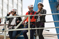 "© Licensed to London News Pictures. 10/06/2015. London, UK. Emma Willis, Matt Baker and Alex Jones prepare to take part in a ""leap of faith"" stunt at the new BBC Broadcasting House. Photo credit : Vickie Flores/LNP"