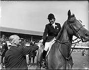 02/08/1960<br /> 08/02/1960<br /> 02 August 1960<br /> R.D.S Horse Show Dublin (Tuesday). Miss Pat Smythe on &quot;Flanagan&quot; winner of the International Jumping competition receives  her rosette from Baron R. de Soultrait (F.E.Q.) at the Dublin Horse Show.