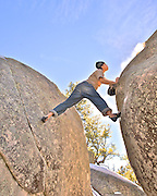 GP Salvo cleaning his FA of the Alien boulder, Wolf Creek, AZ