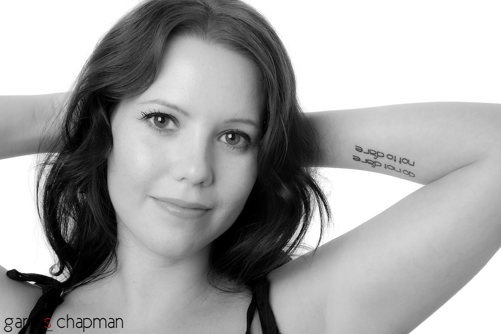 "A jazz singer and photographer, Sarah Mica recently got a tattoo on her left arm. It's a quote from A Horse and His Boy by C.S. Lewis, ""Do not dare not to dare."""