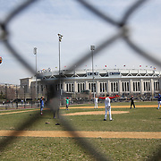 A baseball team warm up in Heritage Field next to Yankee Stadium during the New York Yankees Vs Toronto Blue Jays season opening day at Yankee Stadium, The Bronx, New York. 6th April 2015. Photo Tim Clayton