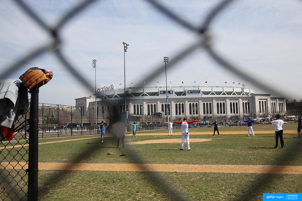 A baseball team warm up in Heritage Field next to Yankee Stadium during the New York Yankees Vs Toronto Blue Jays season opening day at Yankee Stadium, The Bronx, New York. 6th April 2015. Photo Tim Clayton