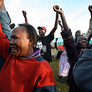 Kenyans cheer after Barack Obama is announced president in the village where his Kenyan relatives reside, November 5, 2008. Photo by Evelyn Hockstein for The New York Times.