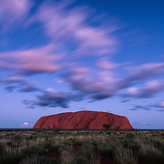 Dusk at Uluru with dramatic clouds