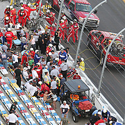 Injured spectators, track workers and rescue workers are seen after a horrific wreck involving driver Kyle Larson, that occurred on the last lap. .Debris scattered into the spectator grandstand area on the front stretch during a NASCAR Drive for COPD 300 race at Daytona International Speedway on Saturday, February 23, 2013 in Daytona Beach, Florida.  ( Photo/Alex Menendez)