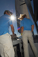 Two sailors on sailboat