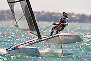 Glenn Ashby (AUS111) finishing second in race nine of the A Class World championships regatta being sailed at Takapuna in Auckland. 16/2/2014