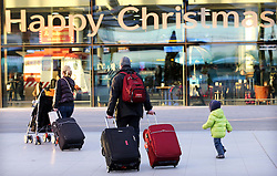 A family arriving  at London Gatwick airport as the Christmas getaway starts Friday, 20th December 2013. Picture by Stephen Lock / i-Images