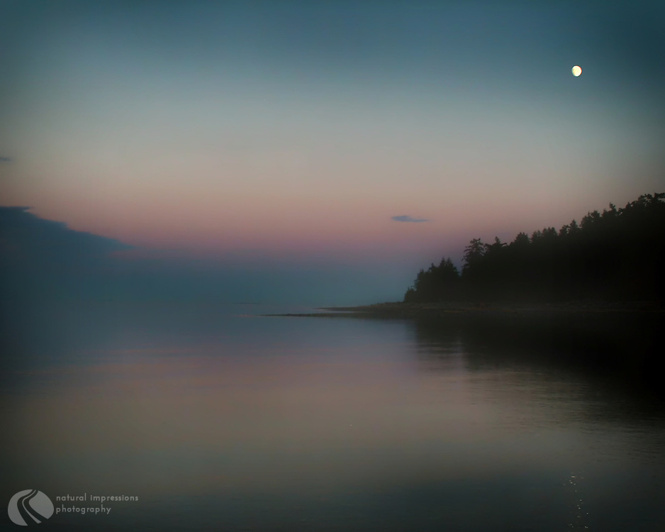 The northernmost tip of Quadra Island sits below a beautiful Canadian moon.  Quadra is one of several islands just off Campbell River, resting in the Straits of Georgia off Vancouver Island and the Sunshine Coast.