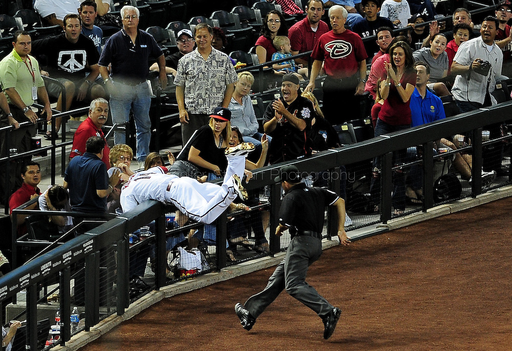 May 19 2011; Phoenix, AZ, USA; Arizona Diamondbacks third basemen Ryan Roberts (14) catches a foul ball hit by Atlanta Braves batter Nate McLouth (13) during the fifth inning against the Atlanta Braves at Chase Field. Mandatory Credit: Jennifer Stewart-US PRESSWIRE