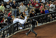 May 19 2011; Phoenix, AZ, USA; Arizona Diamondbacks third basemen Ryan Roberts (14) catches a foul ball hit by Atlanta Braves batter Nate McLouth (13) during the fifth inning against the Atlanta Braves at Chase Field. Mandatory Credit: Jennifer Stewart-US PRESSWIRE