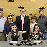 RAY VAN DUSEN/BUY AT PHOTOS.MONROECOUNTYJOURNAL.COM<br /> Amory High School archers, Ashlee Parham, front row, left, and Jessie Davis, signed with Blue Mountain College's first female archery team. Back row, from left, Bradley and Katherine Parham, BMC Coach Clint Gannon and Liz and Marc Davis.