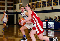 Gilford's Cassidy Bartlett keeps her eye on the ball with Laconia's Cheyanne Zappala during the girls finals Thursday evening at the 42nd annual Holiday Basketball Tournament.   (Karen Bobotas/for the Laconia Daily Sun)