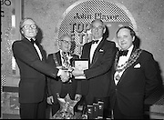 John Player Tops of the Town Final..1980-06-01.1st June 1980.01-06-1980.06-01-80..Photographed at Gaiety Theatre, Dublin....Irish Distillers Variety Group emerge as winner in the John Player Tops of the Town Final. They beat Waterford Banks and Finance by two marks. ..From Left:..Bobby Cooke, Group leader of the Irish Distillers Variety Group holding the Irish National Final Trophy...Alderman William Cummiskey, Lord Mayor of Dublin...Frank O'Reilly, Chairman of John Player, presenting the National Final Trophy...Alderman Stephen Rogers, Mayor of Waterford....