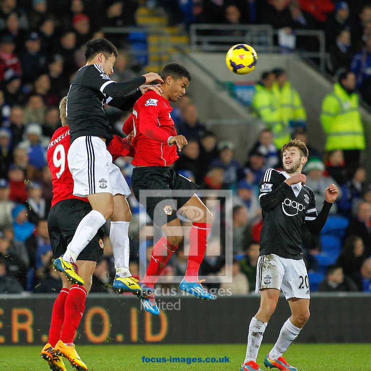 Picture by Mike  Griffiths/Focus Images Ltd +44 7766 223933<br /> 26/12/2013<br /> Fraizer Campbell of Cardiff City and Maya Yoshida of Southampton during the Barclays Premier League match at the Cardiff City Stadium, Cardiff.