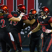 18 November 2017:  The San Diego State football team hosts Nevada Saturday night. San Diego State Aztecs running back Rashaad Penny (20) is congratulated by his teammates after breaking free for a touchdown run in the fourth quarter. The Aztecs beat the Wolf Pack 42-23 at SDCCU stadium. <br /> www.sdsuaztecphotos.com