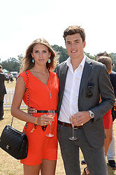 SABRINA PERCY and the HON.PEREGRINE PEARSON at the Veuve Clicquot Gold Cup, Cowdray Park, Midhurst, West Sussex on 21st July 2013.