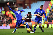 Aston Villa striker Scott Hogan (9) is tackled by Birmingham City defender (on loan from Arsenal) Carl Jenkinson (22) and Birmingham City midfielder David Davis (26) during the EFL Sky Bet Championship match between Aston Villa and Birmingham City at Villa Park, Birmingham, England on 11 February 2018. Picture by Dennis Goodwin.