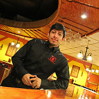 El Jefe owner Luis Ojeda leans against the bar at the Aberdeen Mexican restaurant. While he has worked with his father at other locations, this restaurant venture is Ojeda's first go-round and running his own.