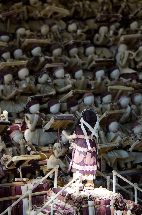 A doll made from totomoxtle, or corn husks, conducts an orchestra of her peers at the Noche de Rabanos festival, Oaxaca, Mexico.