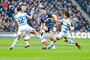 Sean Maitland sends a grubber past Jeronimo de la Fuente during the Autumn Test match between Scotland and Argentina at Murrayfield, Edinburgh, Scotland on 24 November 2018.