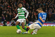 Borna Barisic of Rangers FC slides in to take the ball away from Jeremie Frimpong of Celtic FC during the Betfred Scottish League Cup Final match between Rangers and Celtic at Hampden Park, Glasgow, United Kingdom on 8 December 2019.