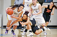 Post Falls High's Rai Franklin dives for a loose ball as Tisha Phillips, left, and Lynzee Wilson from Lewiston High race in to gain control during the first half of the Trojans 51-44 victory Friday over the Bengals in the 5A Region 1 tournament.