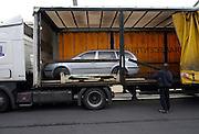 Mlada Boleslav/Tschechische Republik, Tschechien, CZE, 19.03.07: Skoda Octavia wird auf dem Werksgel&auml;nde der Skoda Auto Fabrik in Mlada Boleslav zur Auslieferung auf einen LKW geladen. Der tschechische Autohersteller Skoda ist ein Tochterunternehmen der Volkswagen Gruppe.<br /> <br /> Mlada Boleslav/Czech Republic, CZE, 19.03.07: Skoda Octavia vehicle being loaded on truck for delivery at Skoda car factory in Mlada Boleslav. Czech car producer Skoda Auto is subsidiary of the German Volkswagen Group (VAG).