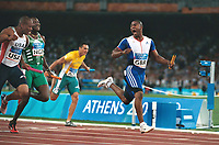 Mark Lewis Francis (GBR) laughs across at American,Maurice Green (USA) after crossing the winning line for the Gold medal.Mens 4 X 100 Relay Final.28/8/2004.Athens Olympics 2004. Credit : Colorsport/Andrew Cowie.