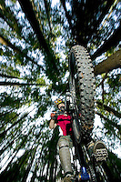 "Young mountain biker in the air off a big ""kicker"" on Quadra Island, largest of the Discovery Islands off of Vancouver Island.  British Columbia, Canada."