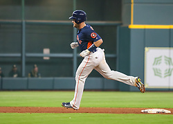 April 29, 2018 - Houston, TX, U.S. - HOUSTON, TX - APRIL 29:  Houston Astros catcher Max Stassi (12) rounds the bases as umpires call an out.  It was later determined that a fan reached out and caught the ball during the baseball game between the Oakland Athletics and Houston Astros on April 29, 2018 at Minute Maid Park in Houston, Texas.  (Photo by Leslie Plaza Johnson/Icon Sportswire) (Credit Image: © Leslie Plaza Johnson/Icon SMI via ZUMA Press)