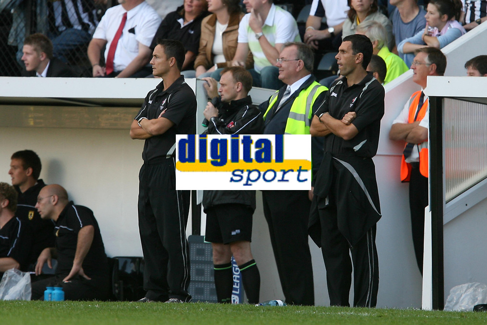 Photo: Pete Lorence.<br />Notts County v Swindon Town. Coca Cola League 2. 23/09/2006.<br />Swindon manager Dennis Wise (L) and assistant Gus Poyet (R) watch of the match.