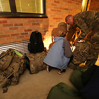 Courtney Chatham of Memphis tennessee helps her husband, Carl, make sure he has everything in his bag before he leaves with his unit the 155th HHC from their facility in Tupelo Tuesday morning.