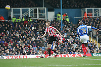 Photo: Lee Earle.<br /> Portsmouth v Sheffield United. The Barclays Premiership. 23/12/2006. Rob Hulse (L) heads home Sheffield United's opening goal watched by Sol Campbell (R).