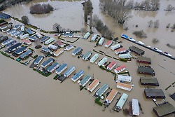 DATE CORRECT AS CAPTIONED  © Licensed to London News Pictures. 22/12/2019. Yalding, UK. Boats are moored on the river Medway (R) as flood water has inundated the Little Venice caravan park near Yalding in Kent after the River Medway burst its banks. River levels remain high after a second night of heavy rain in the south. More rain is expected today. Photo credit: Peter Macdiarmid/LNP