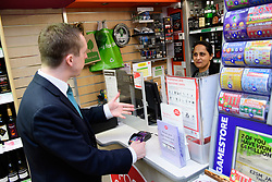 Pictured is Tom Pursglove MP, left, with postmistress Devyani Tailor using the Post Offices banking facilities<br /> <br /> Tom Pursglove MP has officially opened the new Post Office at the Weldon Supermarket in Weldon.<br /> <br /> Date: November 10, 2017