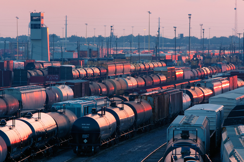 As the sun sets on a warm summer evening, its rays catch the multitude of freight cars in the Union Pacific's giant Proviso Freight Yard in suburban Chicago, IL.