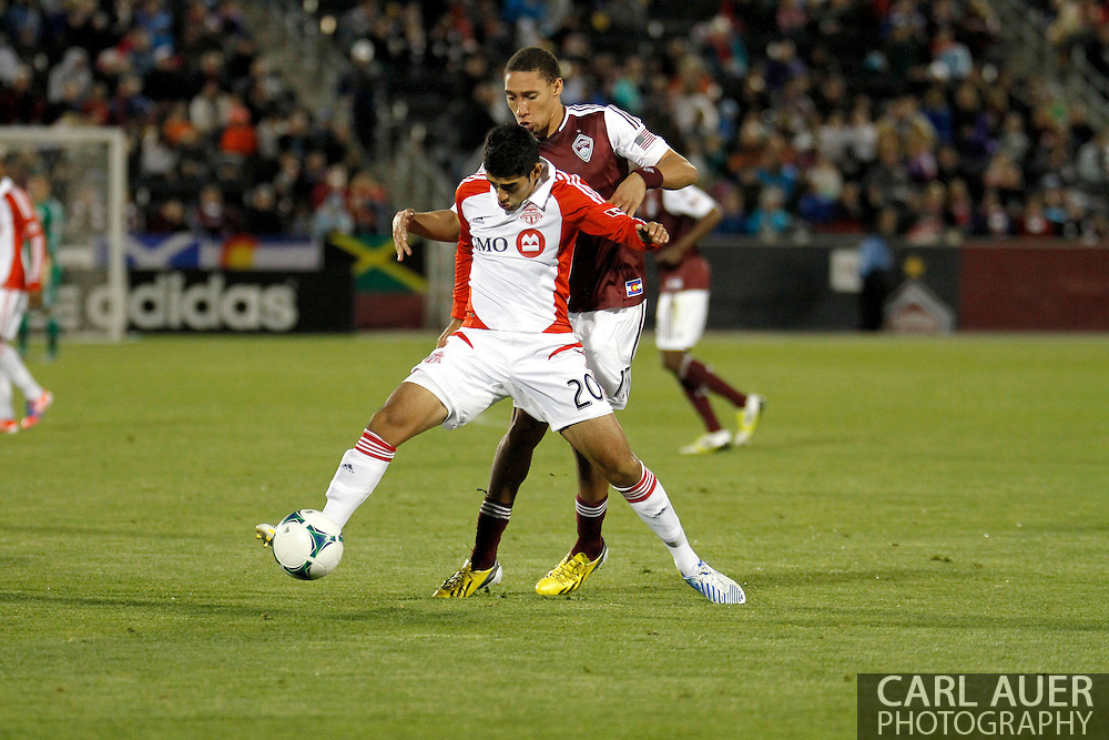 May 4th, 2013 Commerce City, CO - Toronto FC forward Justin Braun (17) attempts to keep the ball away from Colorado Rapids defender Chris Klute (15) in the second half of the MLS match between the Toronto FC and the Colorado Rapids at Dick's Sporting Goods Park in Commerce City, CO