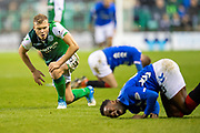 Ryan Porteous (#36) of Hibernian FC gets up off the ground, after fouling Lassana Coulibaly (#23) of Rangers FC (foreground) during the Ladbrokes Scottish Premiership match between Hibernian and Rangers at Easter Road, Edinburgh, Scotland on 19 December 2018.