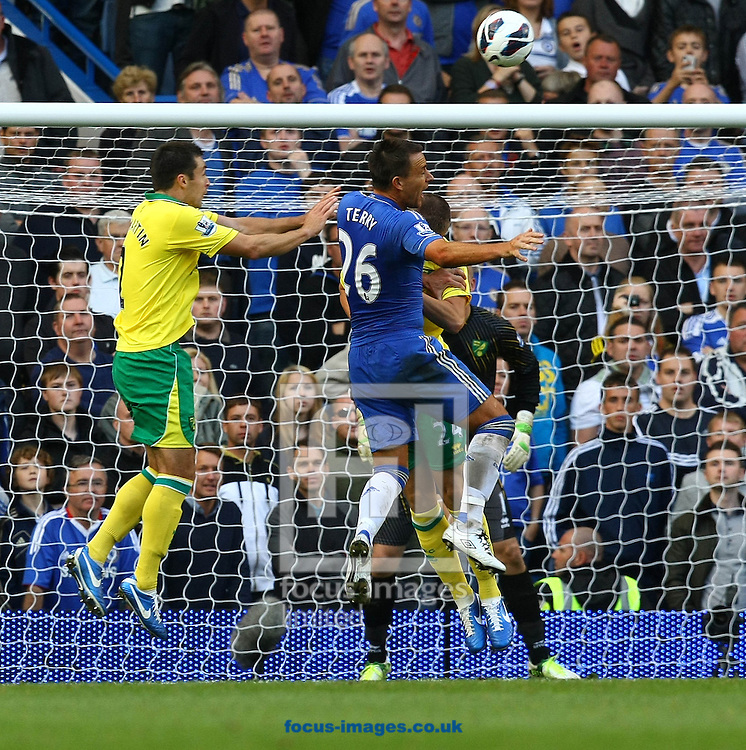 Picture by Paul Chesterton/Focus Images Ltd +44 7904 640267.06/10/2012.Russell Martin of Norwich beats John Terry of Chelsea to a header during the Barclays Premier League match at Stamford Bridge, London.