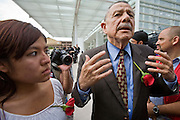 "29 JULY 2010 - PHOENIX, AZ: Alfredo Gutierrez (CQ) right talks to reporters before US Marshals arrested him at the Sandra Day O'Connor Courthouse Thursday. Dozens of people were arrested during protests against SB 1070 across central Phoenix Thursday. US Judge Susan Bolton's ruling Wednesday stopped four of SB 1070's more than a dozen provisions from going into effect. She wrote, ""The court also finds that the United States is likely to suffer irreparable harm if the court does not preliminarily enjoin enforcement of these sections,"" she states in the ruling. ""The balance of equities tips in the United States' favor considering the public interest.""     PHOTO BY JACK KURTZ"