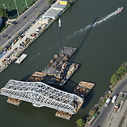 Willis Ave Bridge gets moved down the river to its final destination.