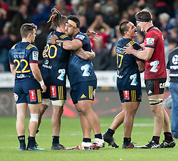 Highlanders' players celebrate their team's victory as Daniel Lienert-Brown, second right, and Crusaders' Luke Romano share a joke at the end of the Super Rugby match, Forsyth Barr Stadium, Dunedin, New Zealand, Saturday, March 17, 2018. Credit:SNPA / Adam Binns ** NO ARCHIVING**