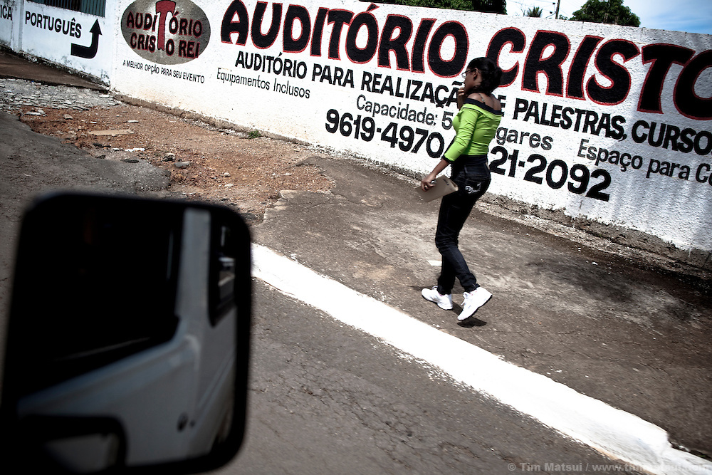 A woman on the streets of Luziania, Brazil.