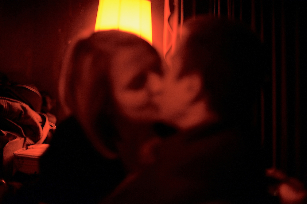 Couple kissing in bar, Manhattan.