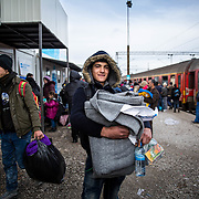 """Ahmed, 16, a Kurdish boy with a sweet demeanor from Aleppo, Syria, arrived at the Tabanovce Train Station in Macedonia before crossing the border into Serbia. Having escaped the war in his home country, Ahmed is traveling alone to try to meet his two brothers in Germany. He said he was travelling solo because, """"The route is too difficult for my mother, she would not be able to make it."""" Refugees traveling solo are common, because it is often too costly for entire families to make the journey—particularly for those who have lost so much in the war. The perilous 4.1 mile dingy ride From Turkey to Greece is on average $2,000. January 2016. Produced for Mercy Corps."""