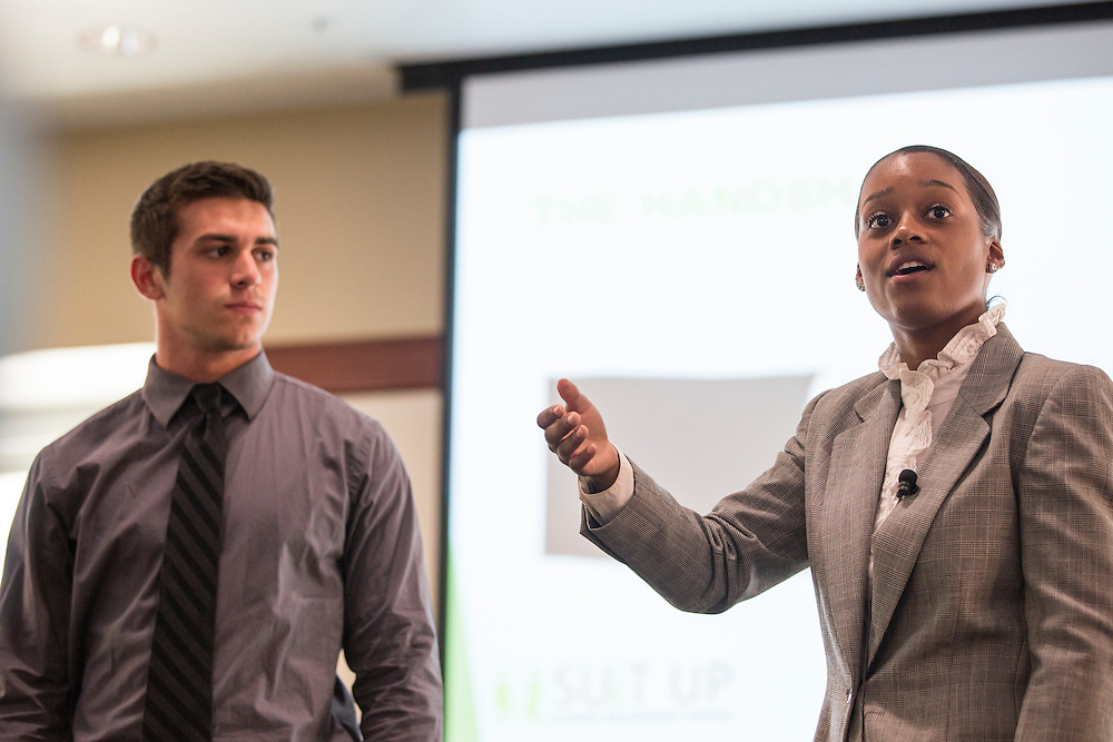 Brittany Tyree, right, the Senior Assistant Director of Career Management, describes characteristics of a good handshake and provides examples of good and bad ones with the help of sophomore business student Brian Wallenhorst at the How to Meet the Firms interactive student workshop on Sept. 6, 2016. After Tyree and Wallenhorst demonstrated, students were encouraged to practice their handshake with others in the room. Photo by Emily Matthews