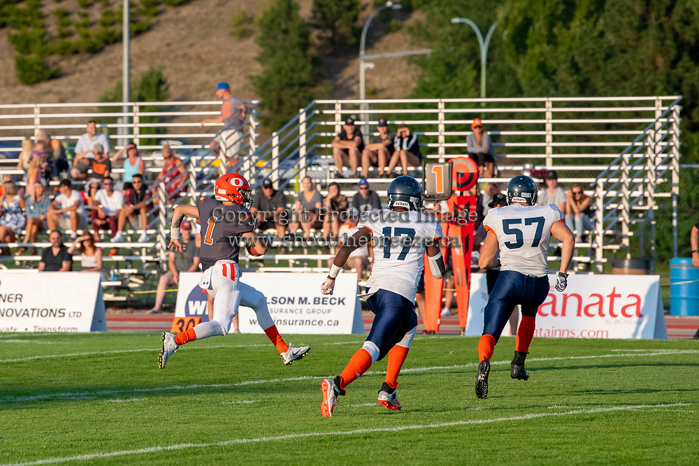 KELOWNA, BC - AUGUST 3:  Ibrahim (Abe) Fimbo LB #17 and Darby Kwan LB #57 of Kamloops Broncos run down Alex Douglas #1 of Okanagan Sun as he runs with the ball during the first quarter at the Apple Bowl on August 3, 2019 in Kelowna, Canada. (Photo by Marissa Baecker/Shoot the Breeze)